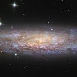 NGC 253, l'univers-île poussiéreuse