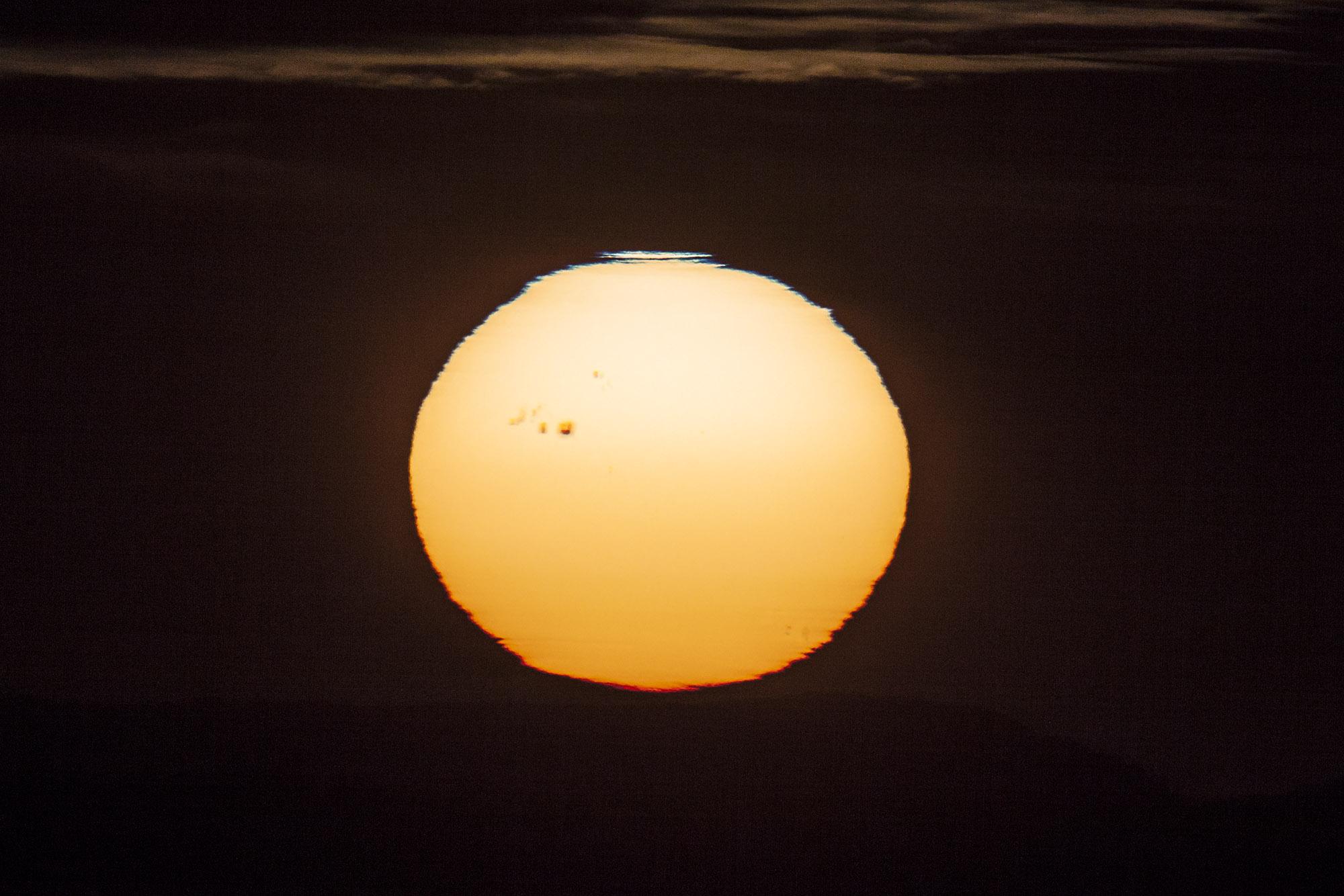 Tache au coucher du Soleil