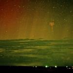 Sylphe rouge et aurore polaire