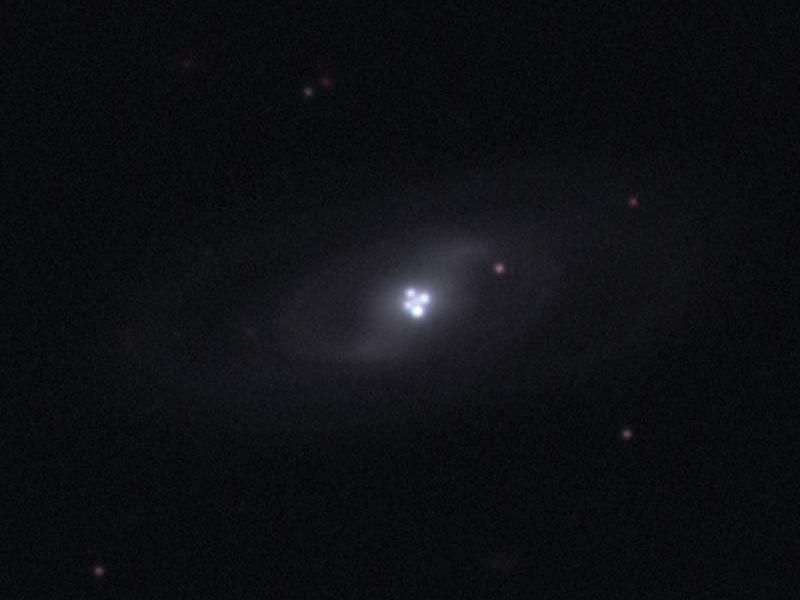 La lentille gravitationnelle de la Croix d\'Einstein