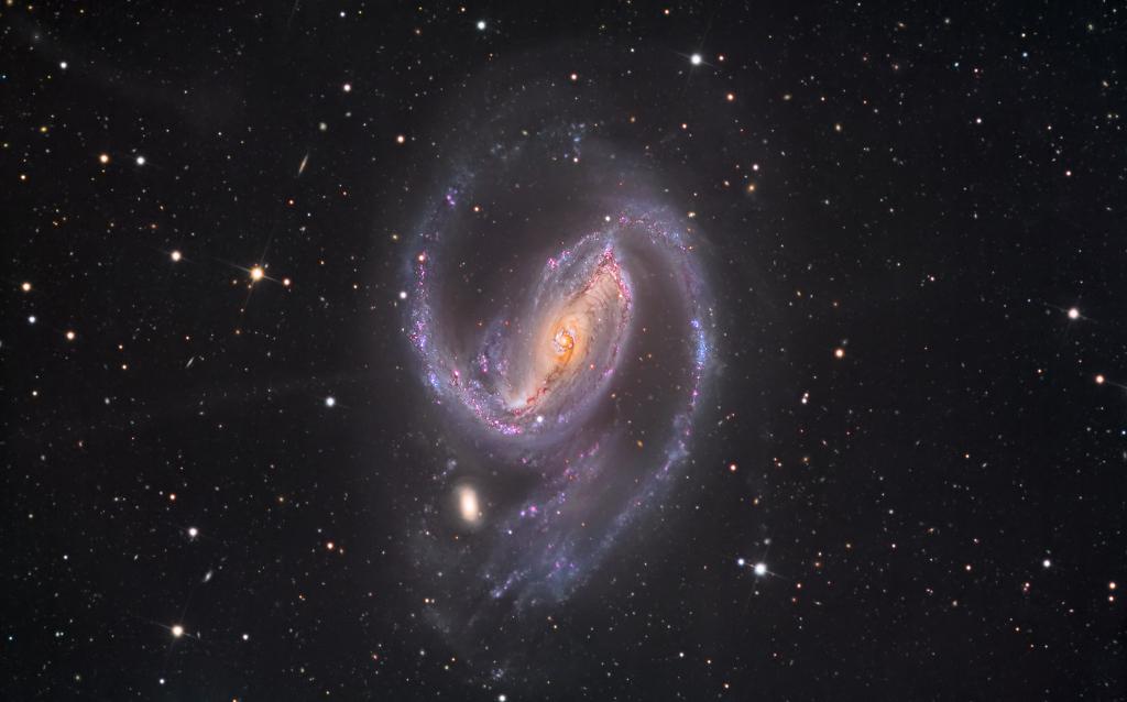 Dans les bras de NGC 1097